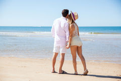 Couple enjoying a walk at the beach together Stock Photography