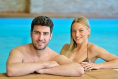 Couple enjoying wellness weekend and spa. Young Couple enjoying wellness weekend and spa royalty free stock photos