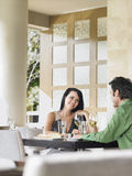 Couple Enjoying Wine At Restaurant Royalty Free Stock Photography