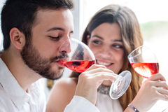 Couple enjoying wine tasting. Close up portrait of Couple enjoying and drinking wine at tasting
