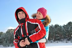 Couple enjoying winter day Stock Photos