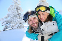 Couple enjoying the winter holidays in the snow royalty free stock photography