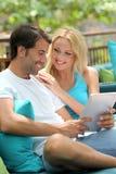 Couple enjoying wireless connection Royalty Free Stock Image