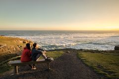 Couple enjoys beautiful coastal scenery near Dunedin in New Zealand royalty free stock photography