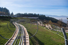 Couple enjoys driving on alpine coaster Stock Images