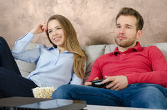 Couple enjoys free time and playing video games. Stock Image