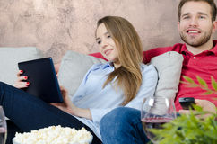 Couple enjoys free time watching TV Stock Images
