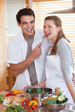 Couple enjoys preparing lunch together Stock Photo