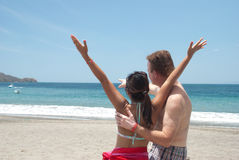 A couple enjoys their visit to a beach Stock Image