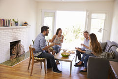 Couple Entertaining Friends At Home Royalty Free Stock Photos