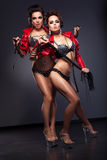 Couple of Enticing Lesbian Flirty Women in Heels - Nightlife Royalty Free Stock Photography