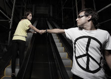 Couple on an escalator stock images