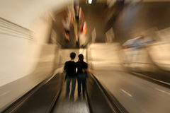 Couple on Escalator. Couple on a subway escalator royalty free stock image