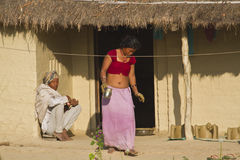 Couple of ethnic taru people in traditional house in Nepal Royalty Free Stock Photography