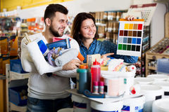 Couple examining color scheme variants royalty free stock images