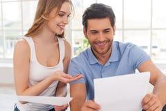 Couple examining documents. Stock Photo