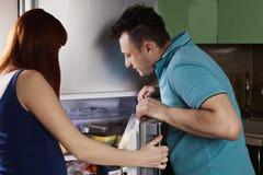 Couple examining fridge content Royalty Free Stock Photography