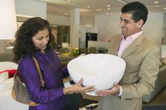 Couple Examining Large Bowl in furniture store Royalty Free Stock Image
