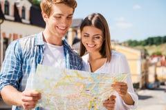 Couple examining map. Stock Image