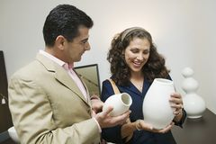 Couple Examining Vases in furniture shop Royalty Free Stock Photo