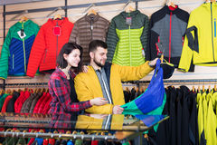 Couple examining windcheaters in store Royalty Free Stock Photography