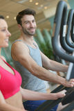 Couple excercising in a fitness center Stock Image