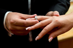 Couple exchanges rings during wedding ceremony. Stock Images
