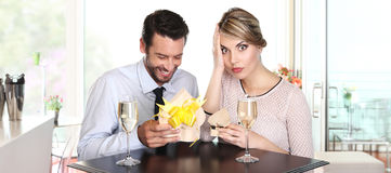 Couple exchanging gifts on a date, to the surprise Stock Images