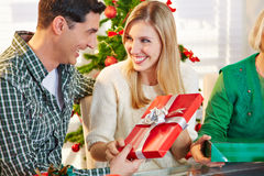 Couple exchanging gifts at Stock Photography