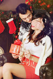 Couple exchanging gifts Stock Photography