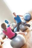 Couple on exercise balls Royalty Free Stock Photo