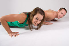 Couple exercising Stock Photos