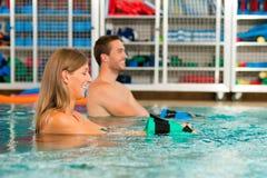 Couple exercising Aquarobics Royalty Free Stock Image