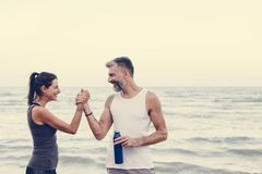 Couple exercising at the beach royalty free stock image