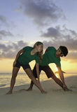 Couple exercising on beach at sunrise Royalty Free Stock Photography