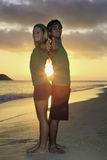 Couple exercising on beach at sunrise Stock Photo