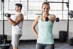 couple exercising with dumbbells in gym Stock Images