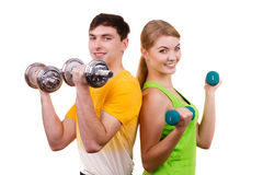 Couple exercising with dumbbells lifting weights Stock Image
