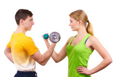 Couple exercising with dumbbells lifting weights Royalty Free Stock Image
