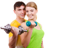 Couple exercising with dumbbells lifting weights Stock Photography