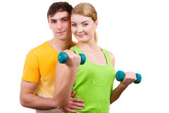 Couple exercising with dumbbells lifting weights Stock Images