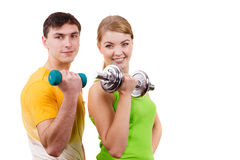 Couple exercising with dumbbells lifting weights Royalty Free Stock Images