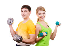 Couple exercising with dumbbells lifting weights Royalty Free Stock Photos