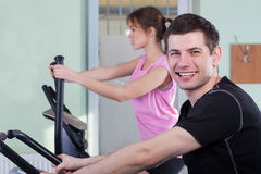 Couple exercising at fitness gym Stock Images