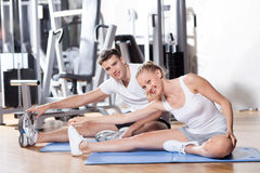 Couple exercising at gym. Young couple in health club Royalty Free Stock Photo
