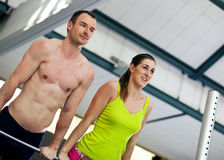 Couple exercising on high bar Stock Photography