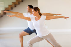 Couple exercising indoors Stock Image