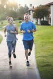 Couple exercising and jogging together at the park Royalty Free Stock Images