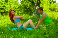Couple exercising on nature Stock Photo