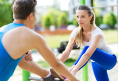 Couple exercising at outdoor gym Stock Image